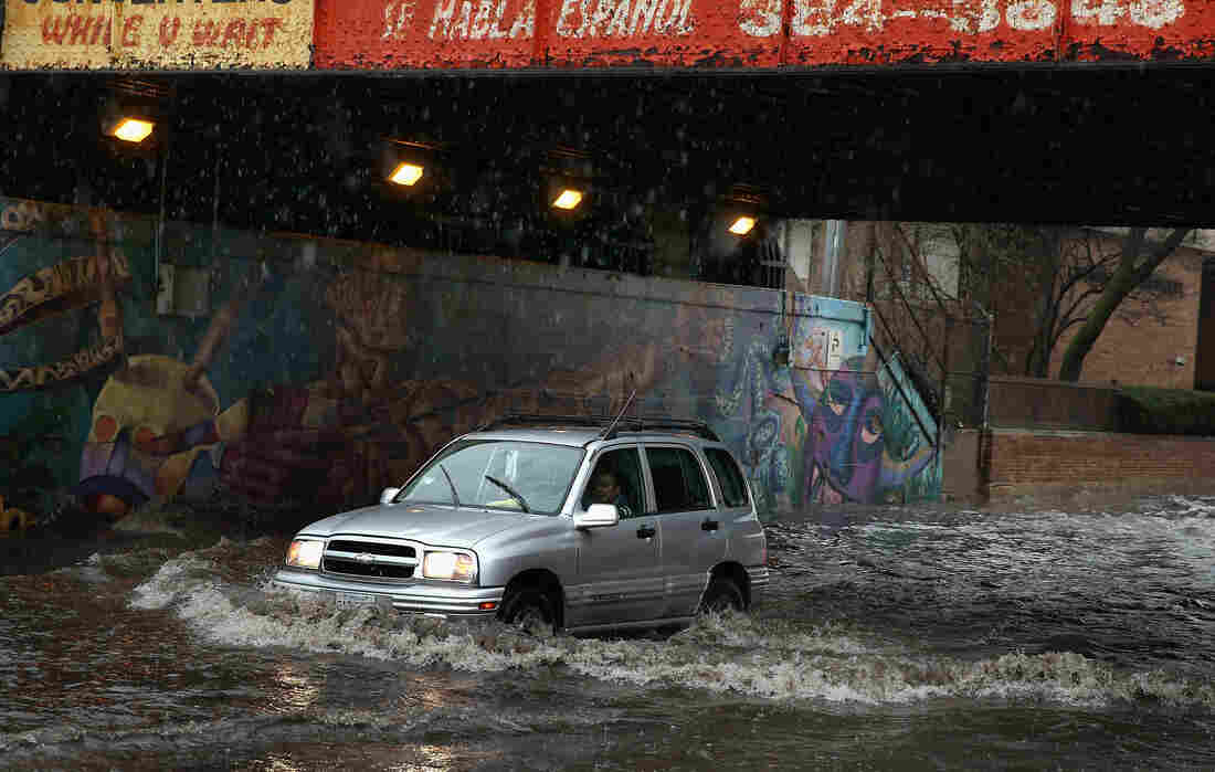 A motorist drives through standing water in a flooded underpass on Thursday in Chicago, Illinois.