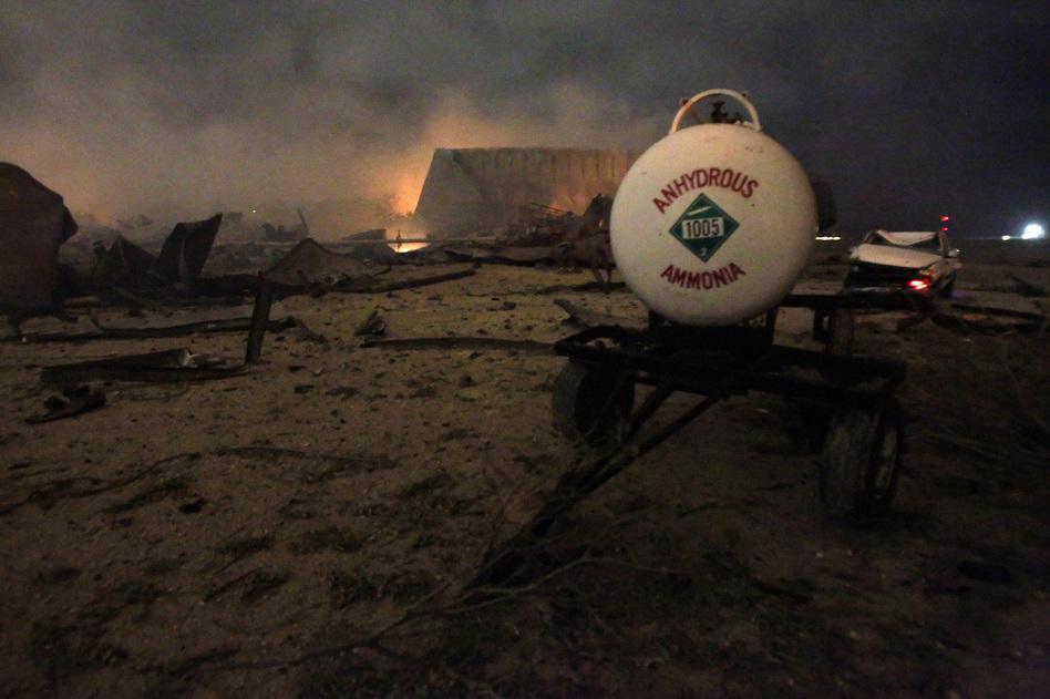 A chemical trailer sits among the remains of a fertilizer plant. (Reuters /Landov)