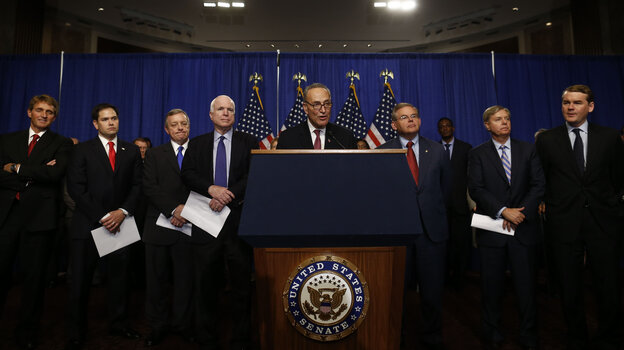 "The ""Gang of Eight"" senators hold a news conference on Capitol Hill on Thursday to discuss their immigration overhaul bill. The senators, from left, are Jeff Flake, R-Ariz., Marco Rubio, R-Fla., Richard Durbin, D-Ill., John McCain, R-Ariz., Charles Schumer, D-N.Y., Robert Menendez, D-N.J., Lindsey Graham, R-S.C., and Michael Bennet, D-Colo."