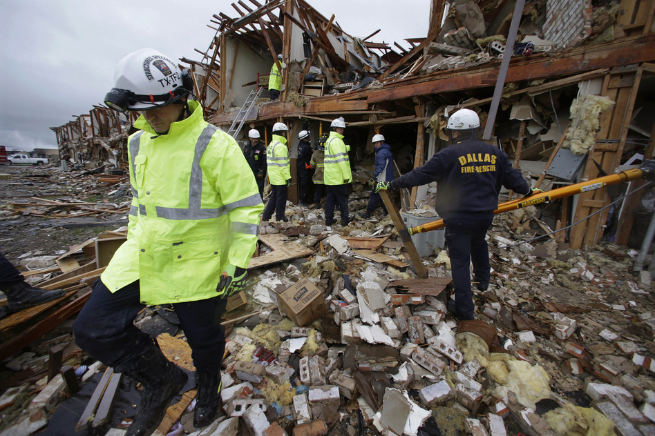 Firefighters conduct a search and rescue on Thursday of an apartment building destroyed by an explosion at a fertilizer plant in West, Texas, late Wednesday. The massive explosion at the plant killed as many as 15 people and injured more than 160. (AP)
