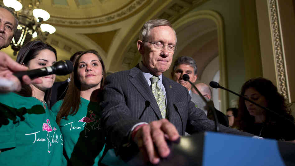 Senate Majority Leader Harry Reid, D-Nev., speaks after losing a vote on broader backgr