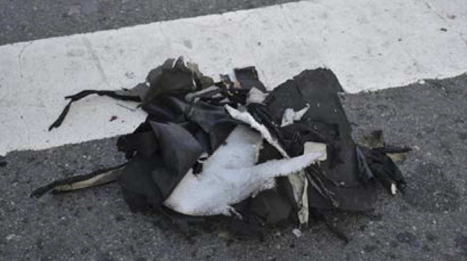 This image shows the remains of a black backpack that the FBI says contained one of the bombs that exploded during the Boston Marathon.