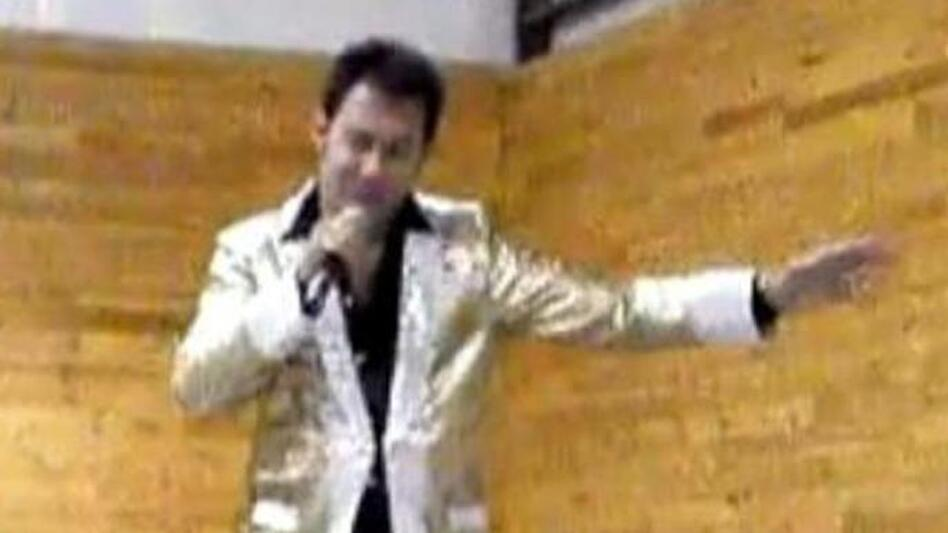 """A screen image from a video on the YouTube channel where Paul Kevin Curtis has posted clips of his performances — in this case, as """"Elvis."""""""
