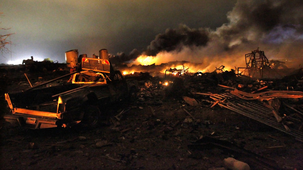 A vehicle is seen near the remains of a fertilizer plant burning after an explosion in West, Texas, near Waco. The  explosion ripped through the fertilizer plant late Wednesday. (Reuters /Landov)