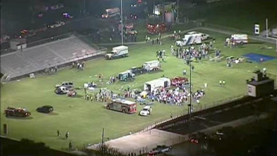 This video image shows injured people being treated on the high school football field turned into a staging area on Wednesday. (AP)