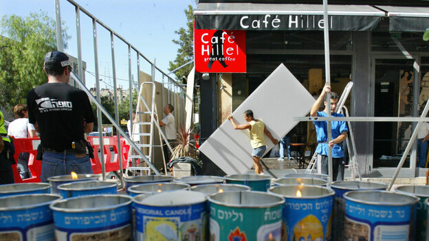 Workers repair the Cafe Hil