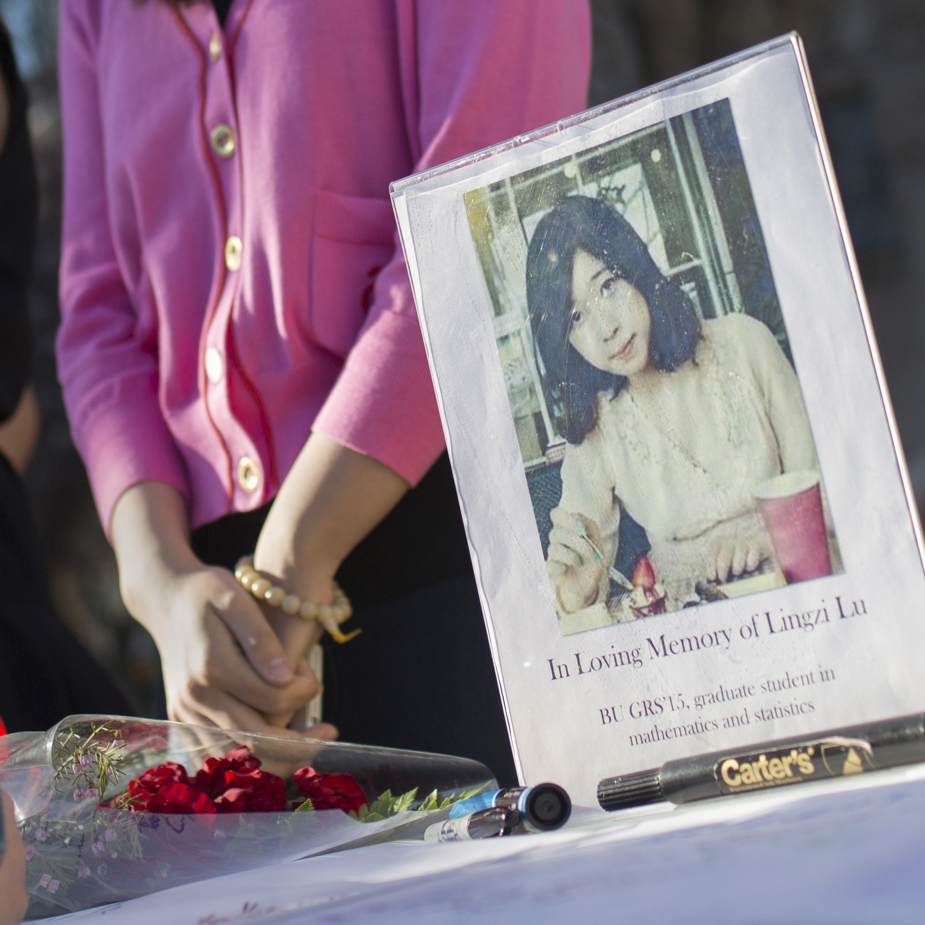 Outside Boston University's Marsh Chapel on Wednesday, friends gathered to remember graduate student Lingzi Lu. She was one of the three people killed in Monday's bombings at the Boston Marathon.
