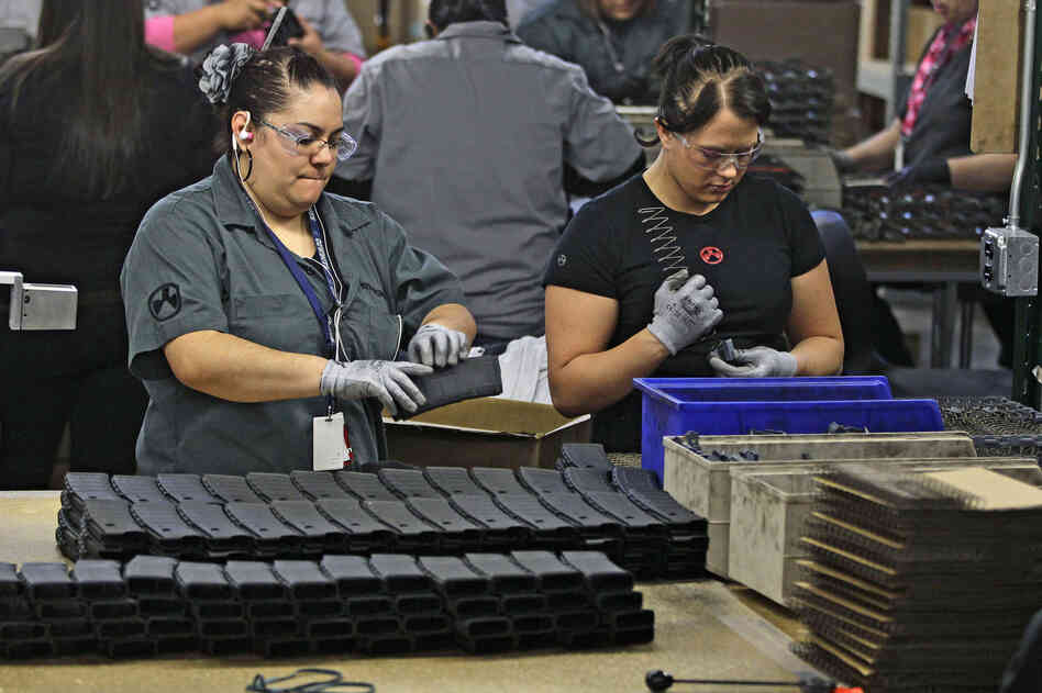 Workers assemble 30-round capacity magazines at the Magpul Industries plant in Erie, Colo. The company, which employs 200 people,