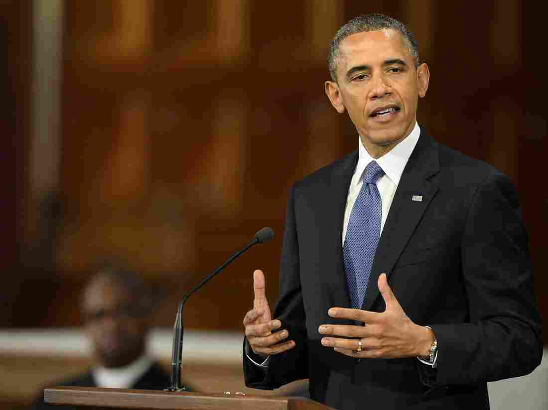 President Obama speaks Thursday during an interfaith service at Cathedral of the Holy Cross in Boston.