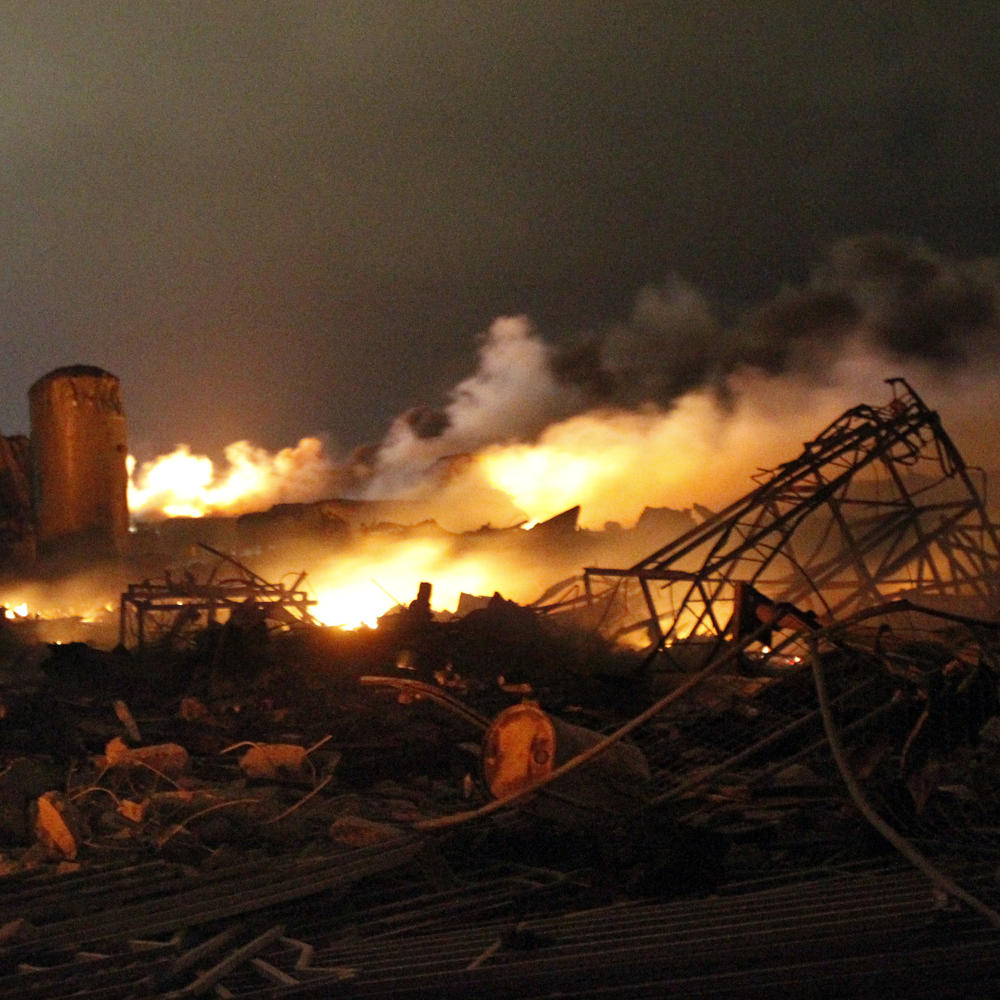 The remains of a fertilizer plant burn after an explosion at the plant in the town of West, Texas.