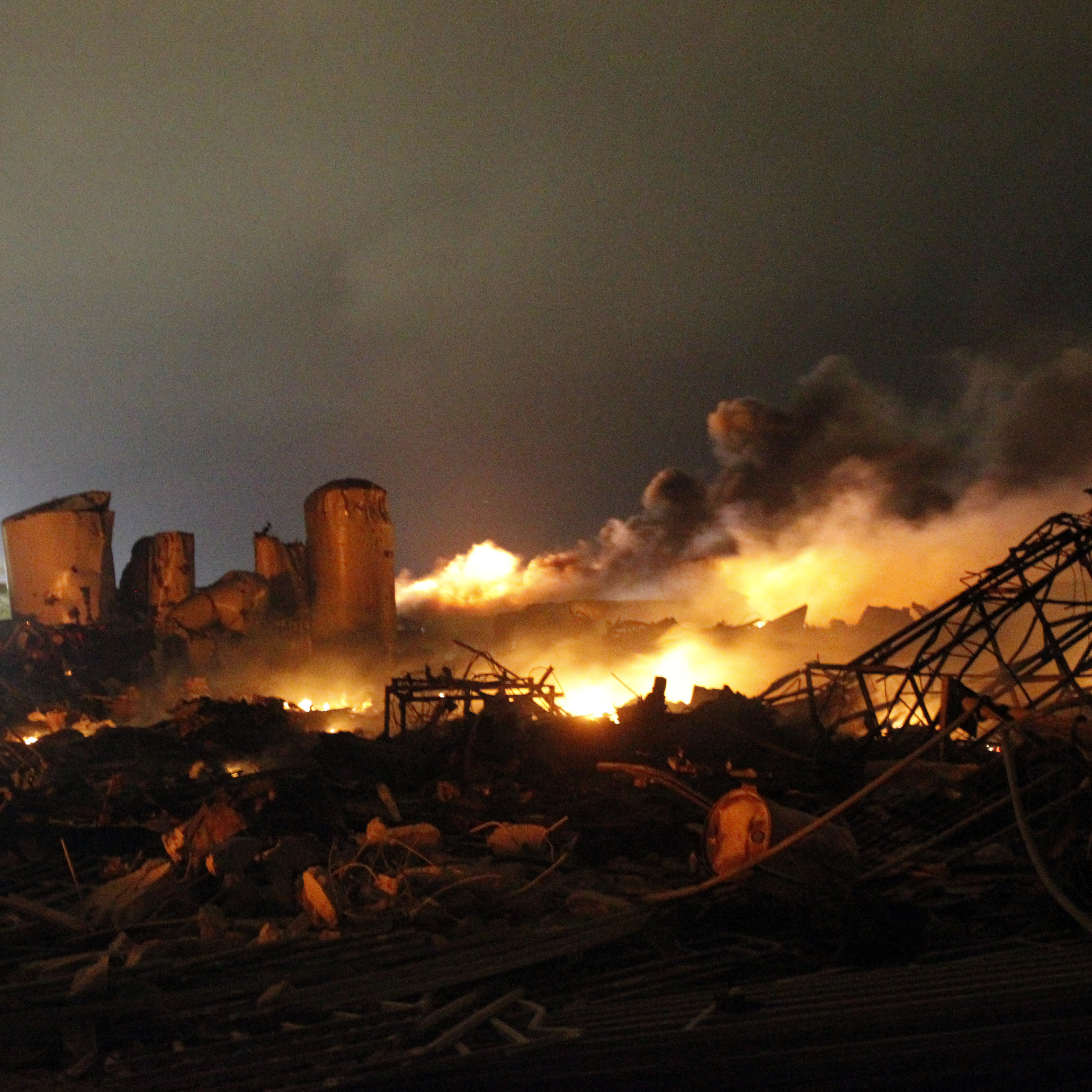 The remains of a fertilizer plant in West, Texas, were still burning early Thursday after an explosion there Wednesday evening.