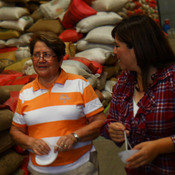 Three women in coffee leading the way: Stephanie Backus of Portland Roasting, coffee farmer Miguelina Villatoro of Guatemala, and coffee exporter/processor Loyreth Sosa. Here they discuss coffee prices as they survey beans ready for milling.