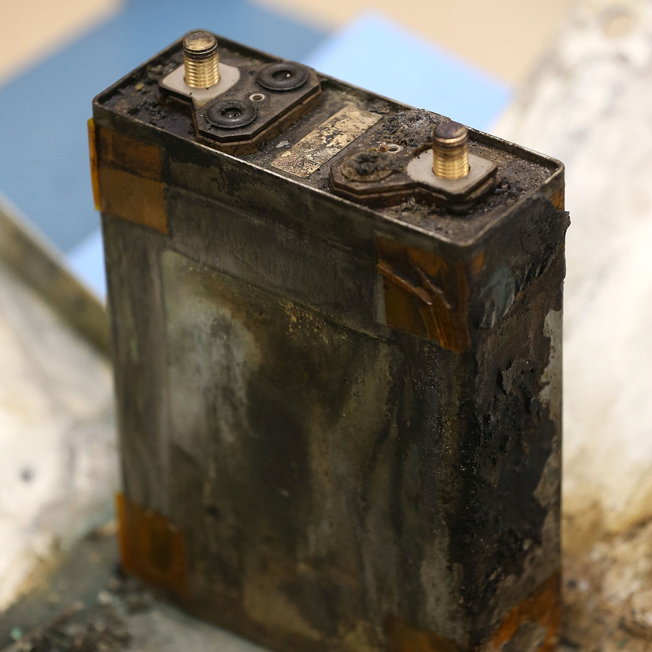 A part of a charred battery from a Japan Airlines 787 on display at the NTSB headquarters in January.