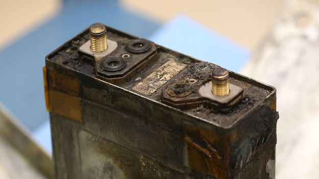 A part of a charred battery from a Japan Airlines 787 on display at the NTSB headquarters in January. (Getty Images)