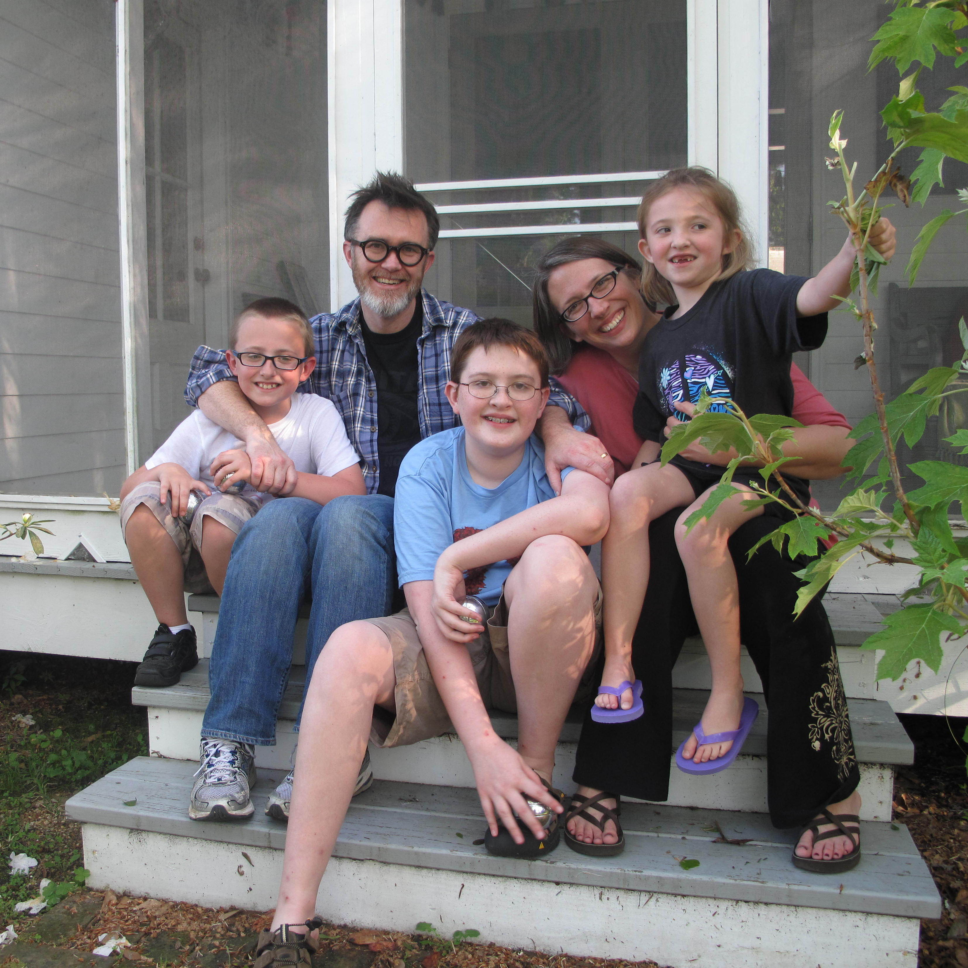 The Drehers -- Lucas (from left), Rod, Matthew, Julie and Nora -- sit on the side stoop at their new home in St. Francisville, La.