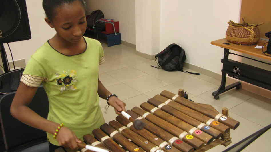 Sara Nimaga plays the balafon in Paul Chandler's music class at the American International School in Bamako, Mali.