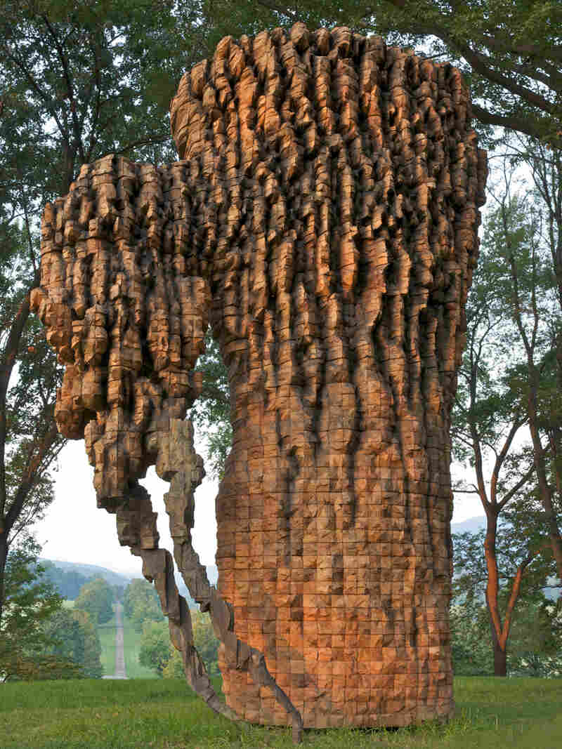 "Luba, 2010. Cedar, graphite, bronze. 212"" x 139"" x 88""."