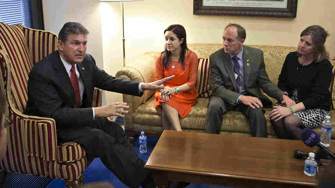 Sen. Joe Manchin, D-W.Va., meets in his office last week with families of victims of the Sandy Hook Elementary School shooting in Newtown, Conn. A bipartisan plan to expand background checks for gun buyers was defeated Wednesday in the Senate.