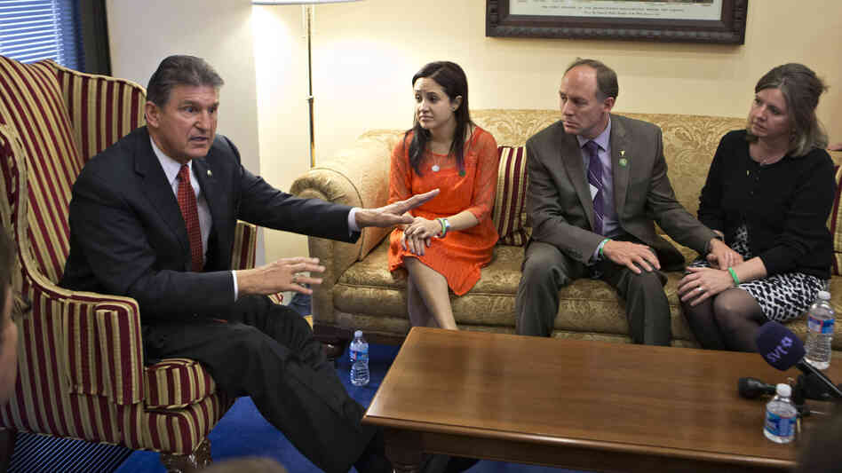 Sen. Joe Manchin, D-W.Va., meets in his office last week with families of victims of the Sandy Hook Elementary School shooting in Newtown, Conn. A bipartisan plan to expand background checks for gun buyers was defeated Wednesday in the Sena