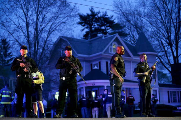 Police officers guard the entrance to Franklin Street in Watertown, Mass., where Boston Police say they have captured the second suspect in the marathon bombings.