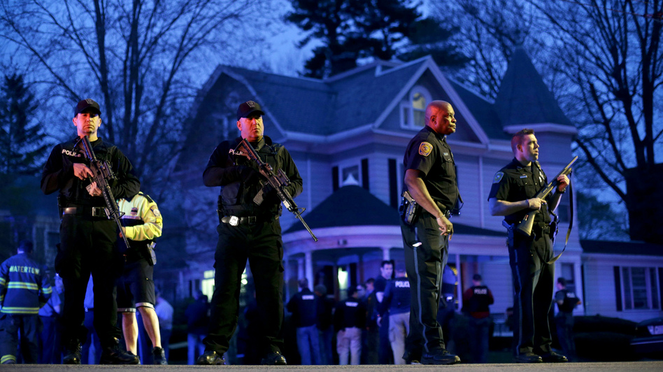 Police officers guard the entrance to Franklin Street in Watertown, Mass., where Boston Police say they have captured the second suspect in the marathon bombings. (AP)