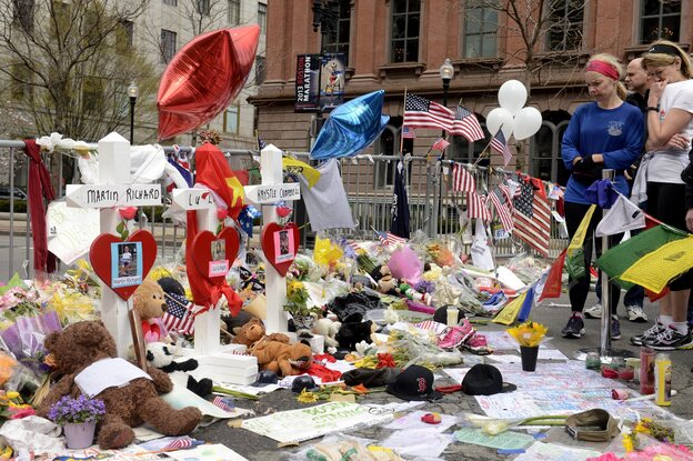A memorial honors the victims of Monday's bombings near the Boston Marathon finish line on Saturday. (EPA /Landov)