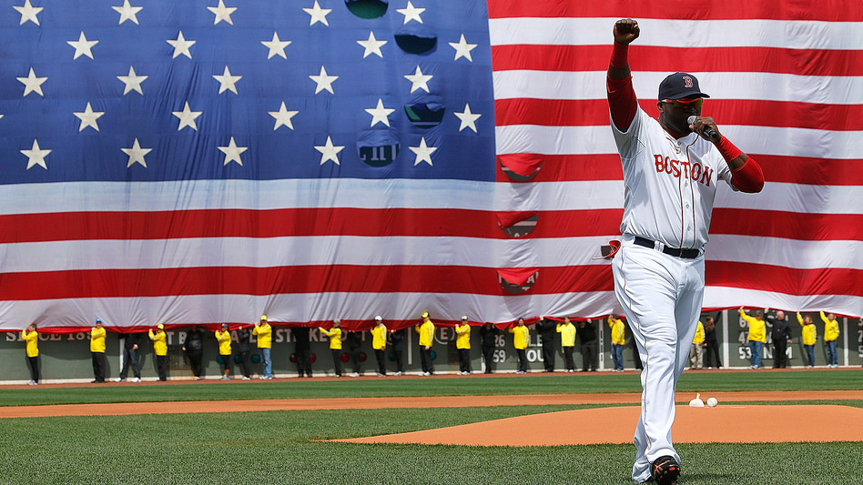 David Ortiz of the Boston Red Sox speaks during a pre-game ceremony in honor of the victims of the marathon bombings at Fenway Park on Saturday. (Getty Images)