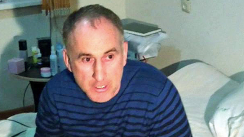 In this image taken from a cellphone video, the father of the Boston bombing suspects, Anzor Tsarnaev, talks to the media about his sons, in his home in Makhachkala, the Dagestani capital, on Friday. (AP)