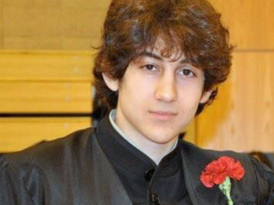 Dzhokhar Tsarnaev, suspected of carrying out the bombing attack on the Boston Marathon, was taken prisoner Friday. Here, he poses for a picture after graduating from Cambridge Rindge and Latin High School. (Robin Young/AP)