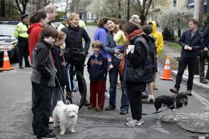 Neighbors gather near the location where Tsarnaev was arrested.
