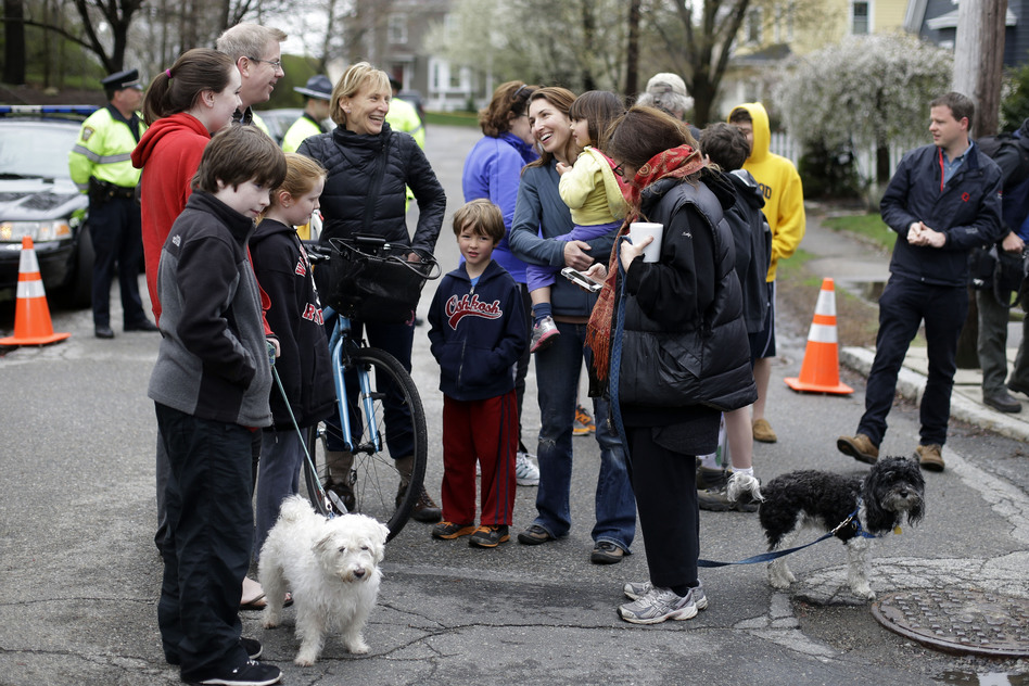 Neighbors gather near the location where Tsarnaev was arrested. (AP)