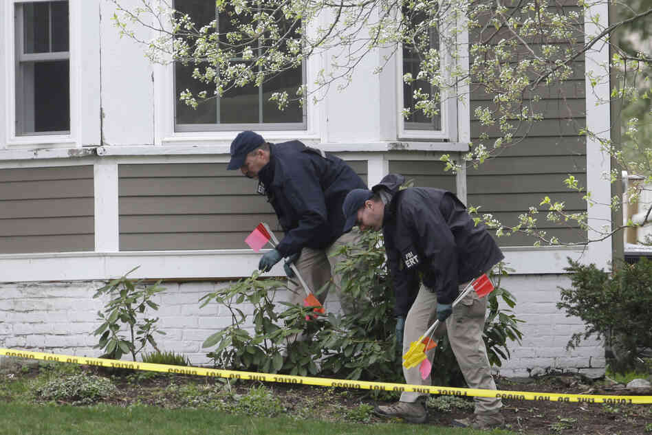 Investigators work near the location where suspect Dzhokhar Tsarnaev was arrested, in Watertown, Mass., on Saturday.