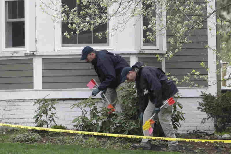 Investigators work near the location where suspect Dzhokhar Tsarnaev was arrested, in Watertown, Mass., on Saturday.