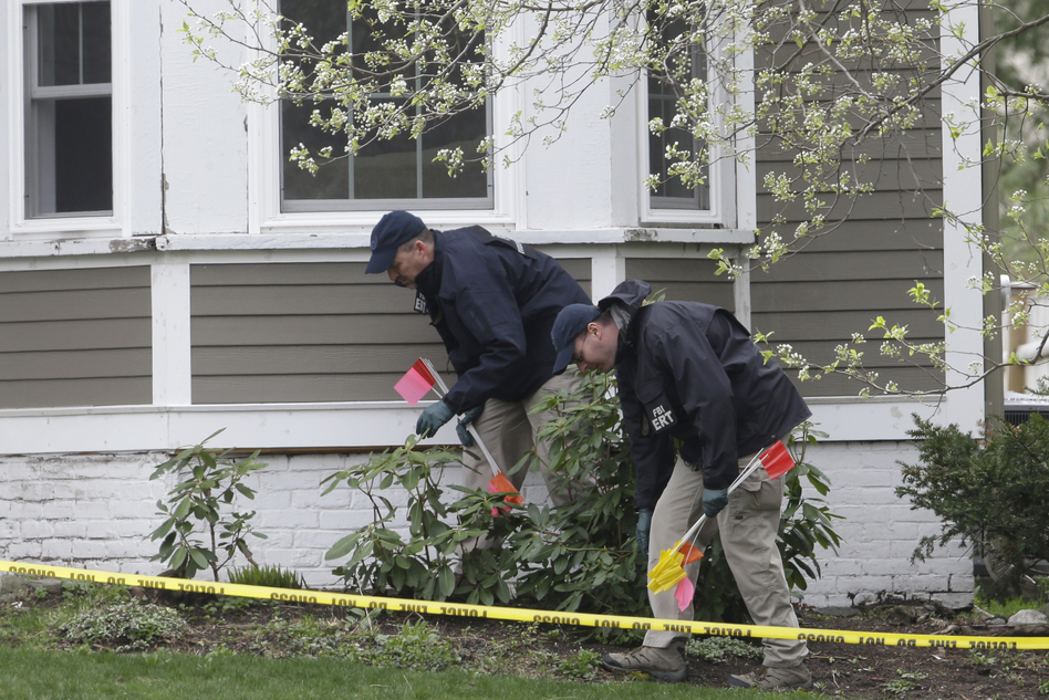 Investigators work near the location where suspect Dzhokhar Tsarnaev was arrested, in Watertown, Mass., on Saturday. (AP)
