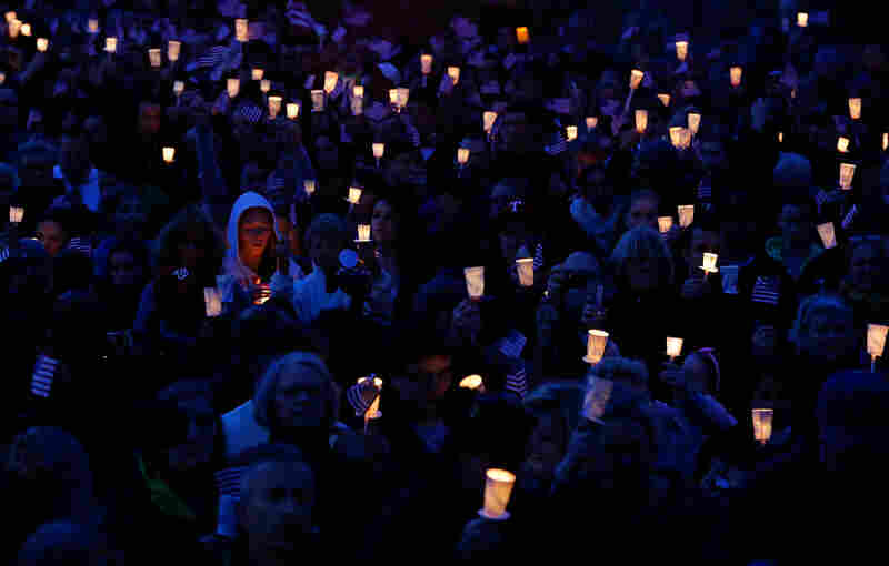 A candlelight vigil is held in honor of 8-year-old Martin Richard, from Dorchester, who was killed by the explosion.