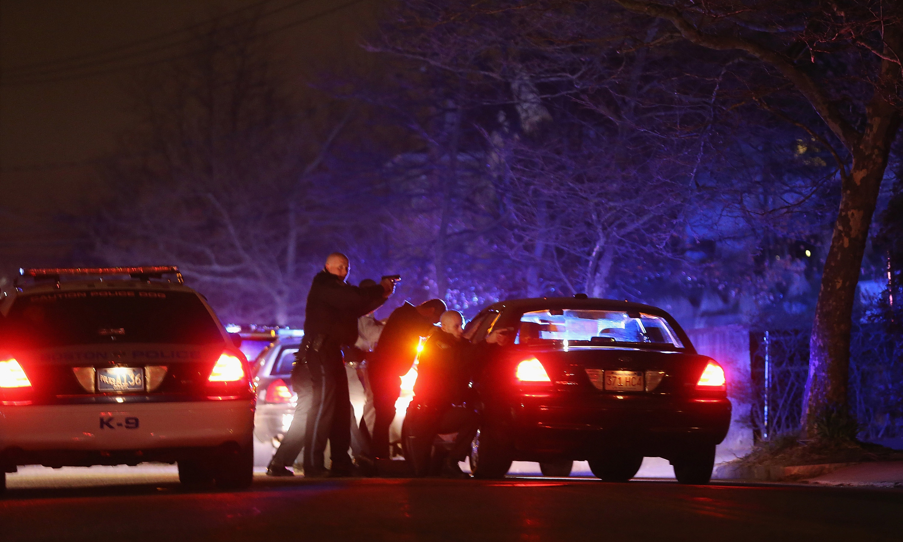 Police search for a suspect on Thursday in Watertown, Mass. An MIT campus police officer was shot and killed late Thursday night at the school's campus in Cambridge.