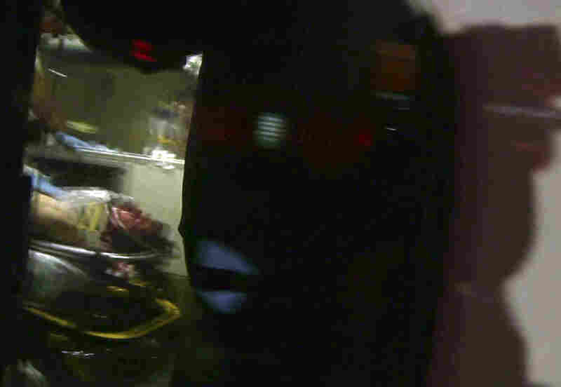 A still frame from video shows Tsarnaev, visible through an ambulance window, after he was apprehended.