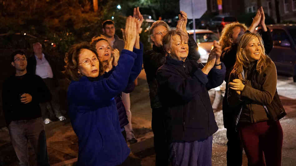 Residents cheer police as they exit Franklin Street, wher