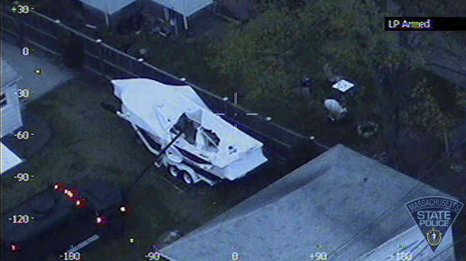 A view from a police helicopter shows a law enforcement vehicle being used to investigate