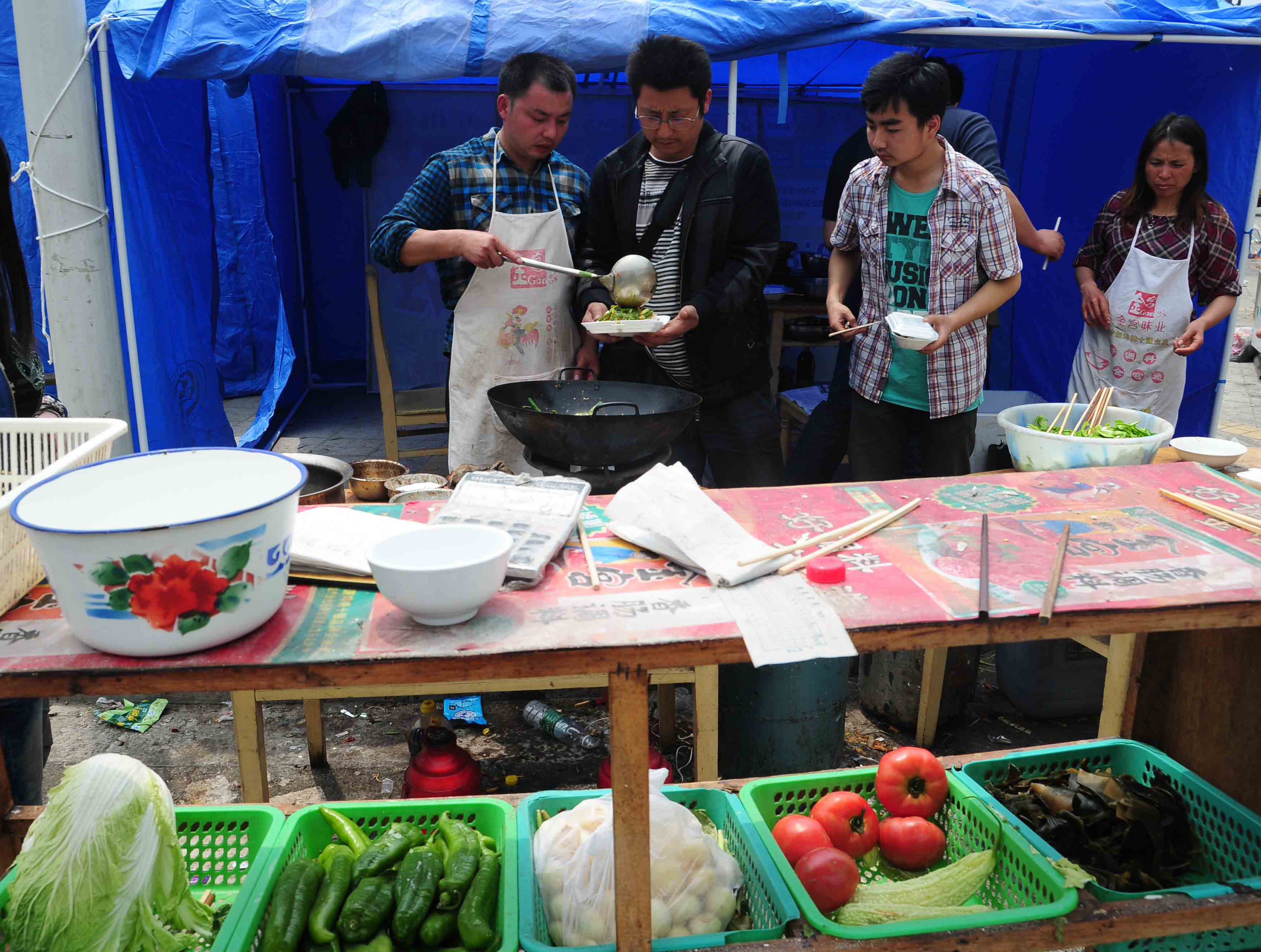 Food is prepared in a temporary settlement in Longmen township, a town close to the epicenter of the earthquake.