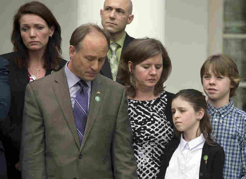 Mark and Jackie Barden (front) lost their 7-year-old son, Daniel, in the Sandy Hook Elementary School shooting in Newtown, Conn., in December. On Wednesday, they stood with their surviving children, Natalie and James, in the White House Rose Garden with President Obama and other Newtown parents after the defeat of a bill to expand background checks on guns.