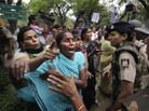 Activists from India's main opposition party jostle with police outside Sonia Gandhi's residence on Sunday.