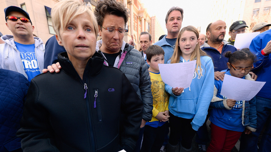 People participate in an interfaith memorial service with members of six churches near the site of Monday's Boston Marathon bombings. (Getty Images)