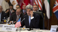 U.S. Secretary of State John Kerry listens in during a