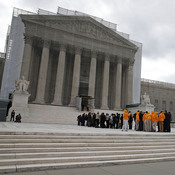 People line up to enter the Supreme Court on Monday for arguments.