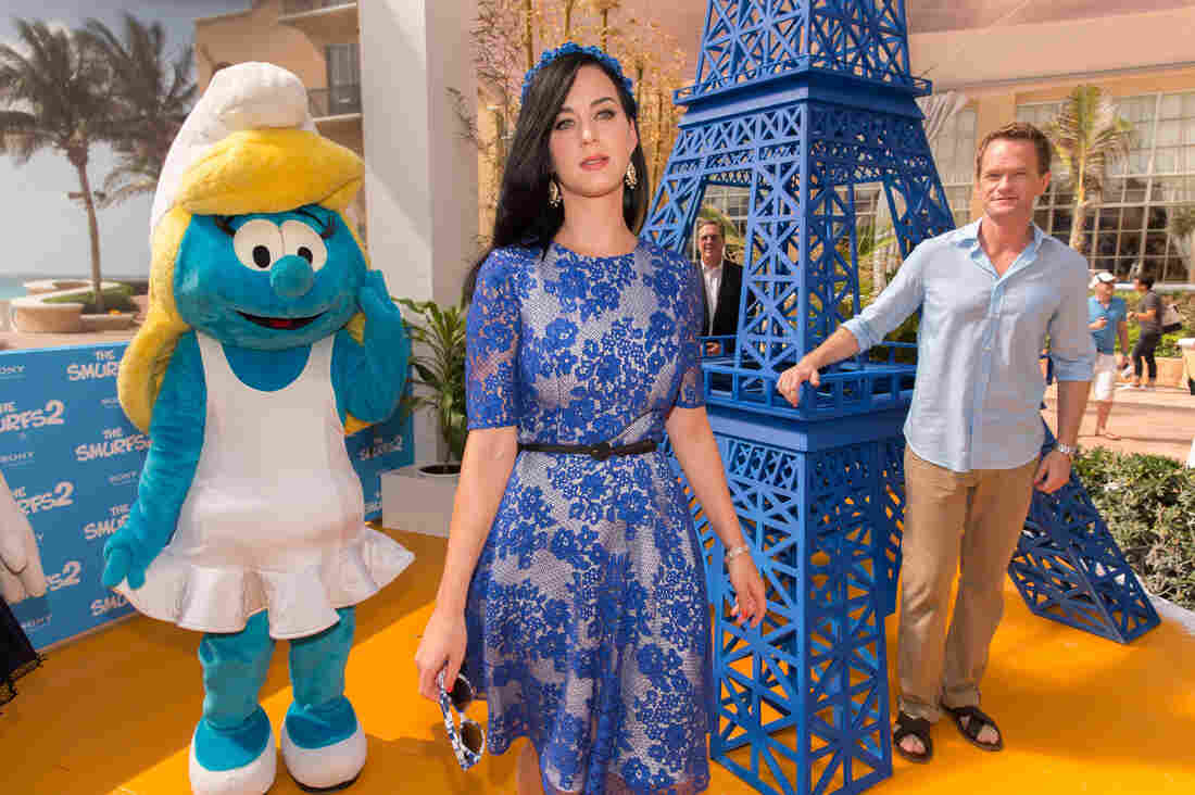 Actors Katy Perry and Neil Patrick Harris pose with Smurfette in Cancun, Mexico.