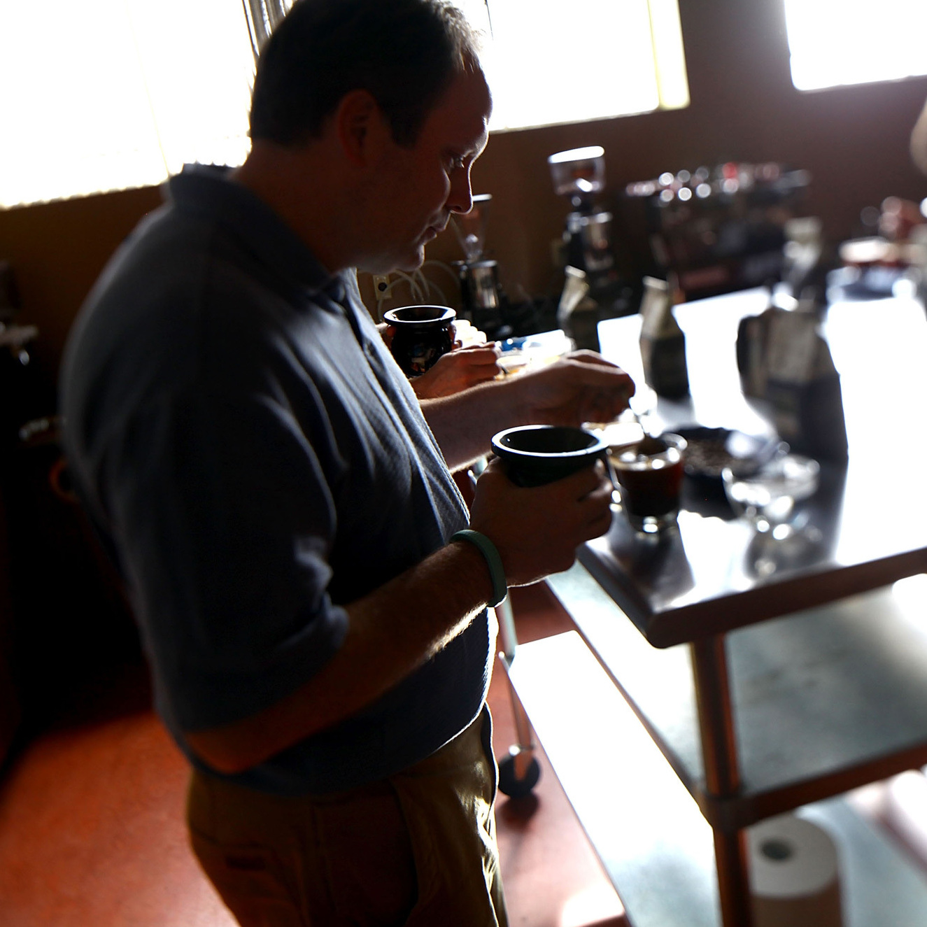 Mark Stell of Portland Roasting samples coffee from his Guatemalan grower.