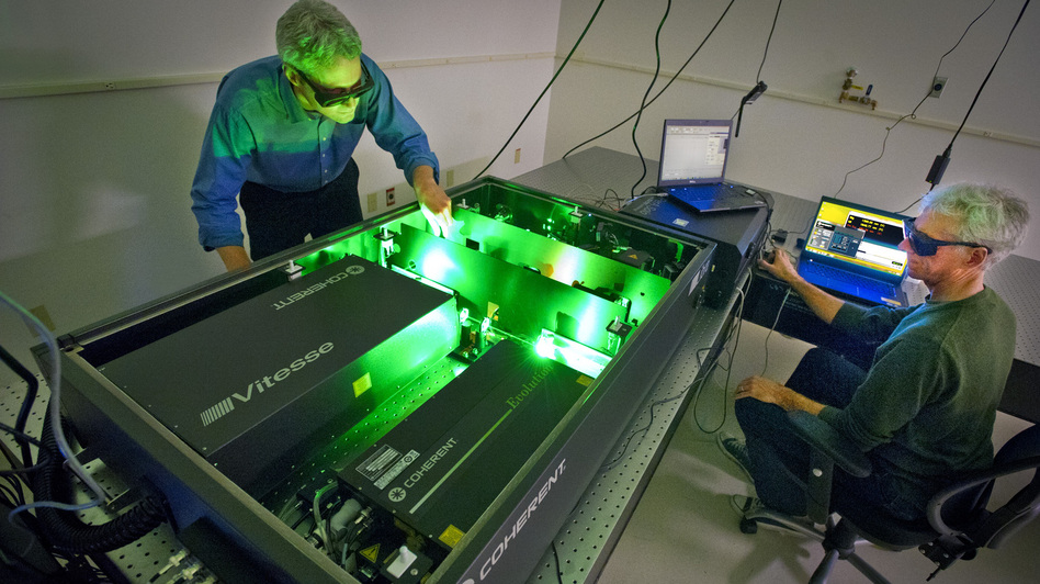 Ian Sharp (left) and Joel Ager use lasers to study the properties of water-splitting materials. The goal is to improve the efficiency with which solar energy can be used to create chemical fuel. (Lawrence Berkeley National Lab)