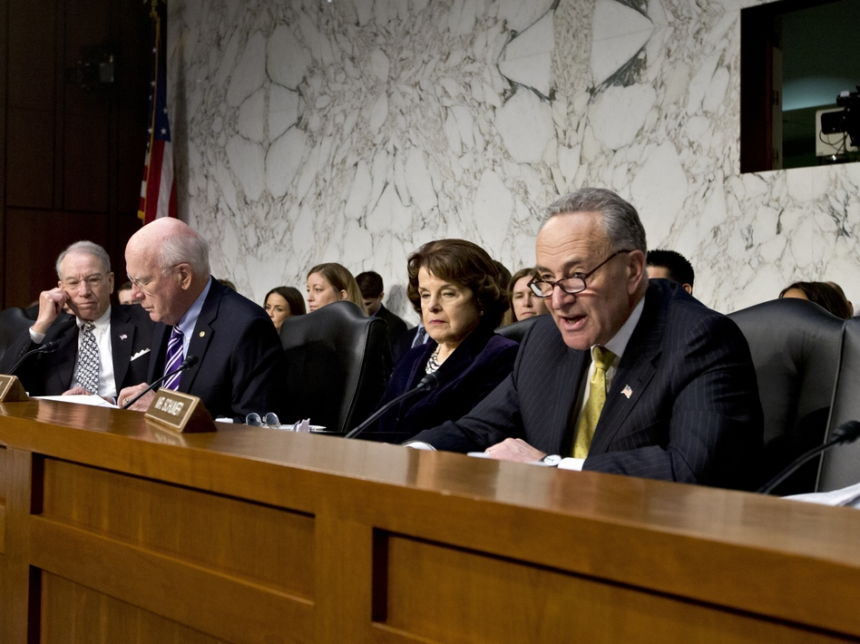 Sen. Chuck Schumer, D-N.Y. (right), talks during a hearing at which he angered Sen. Chuck Grassley, R-Iowa (far left). Grassley thought Schumer was accusing him of using the Boston bombings as an excuse to slow or kill the immigration overhaul. (J. Scott Applewhite/AP)