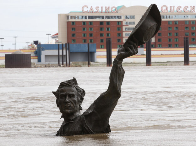 As the Mississippi River has risen in St. Louis, the city's Lewis and Clark statue has — as often hap